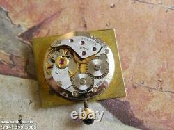 Man's CARTIER TANK Manual Wind, Roman Numerals Dial, One Year Warranty