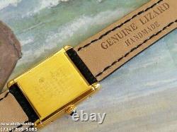 Men's CARTIER TANK Manual Wind, Roman Numerals Dial, One Year Warranty