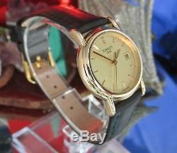 Tissot 18 K Gold Date Watch Eta Movement- G617.330 midi 26 mm One year Warranty